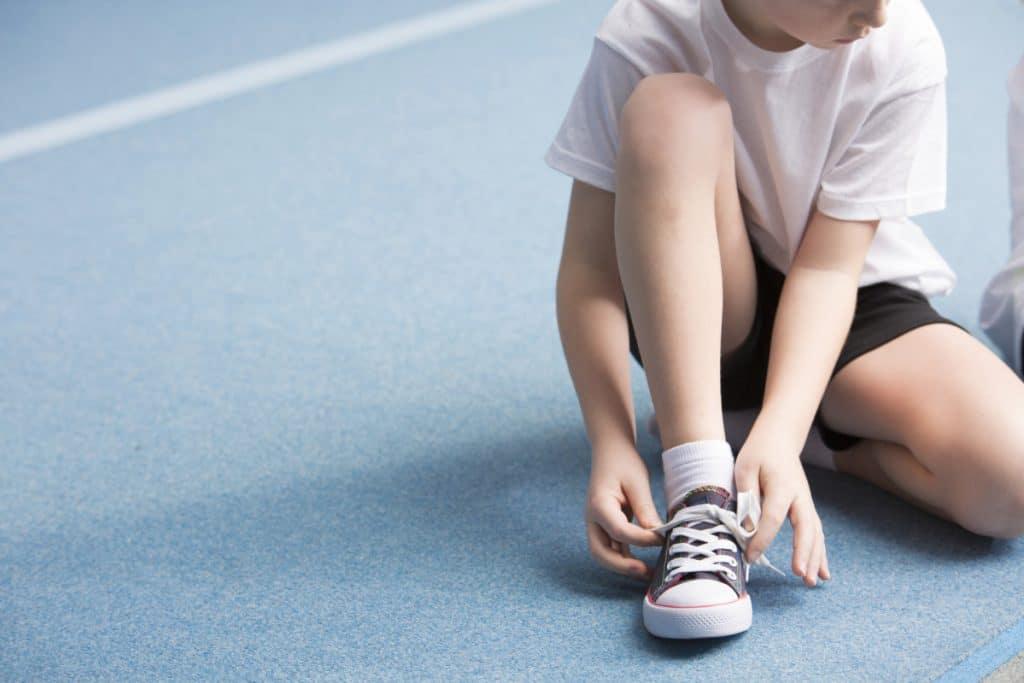 Boy Tying His Shoes