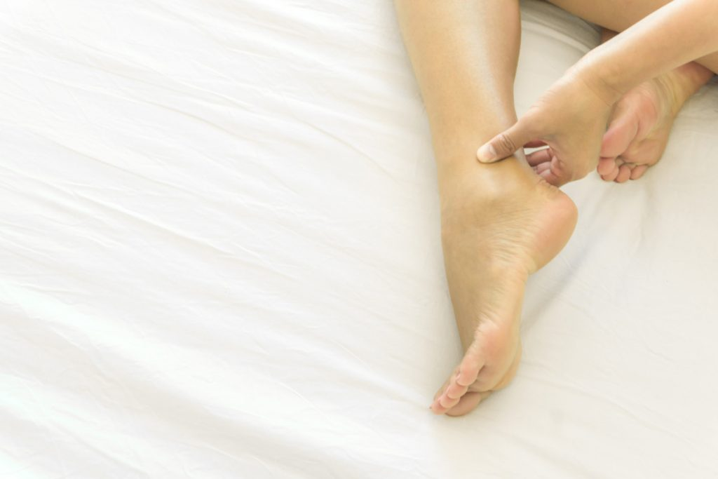 woman with painful sprained ankle