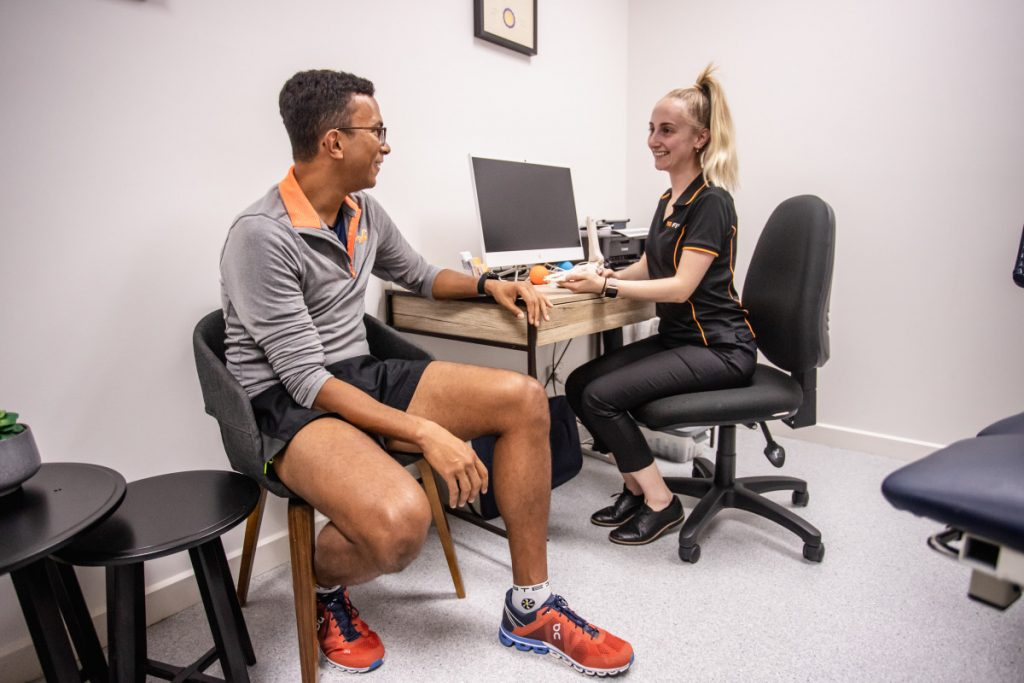 Podiatrist With Patient In Clinic Adelaide