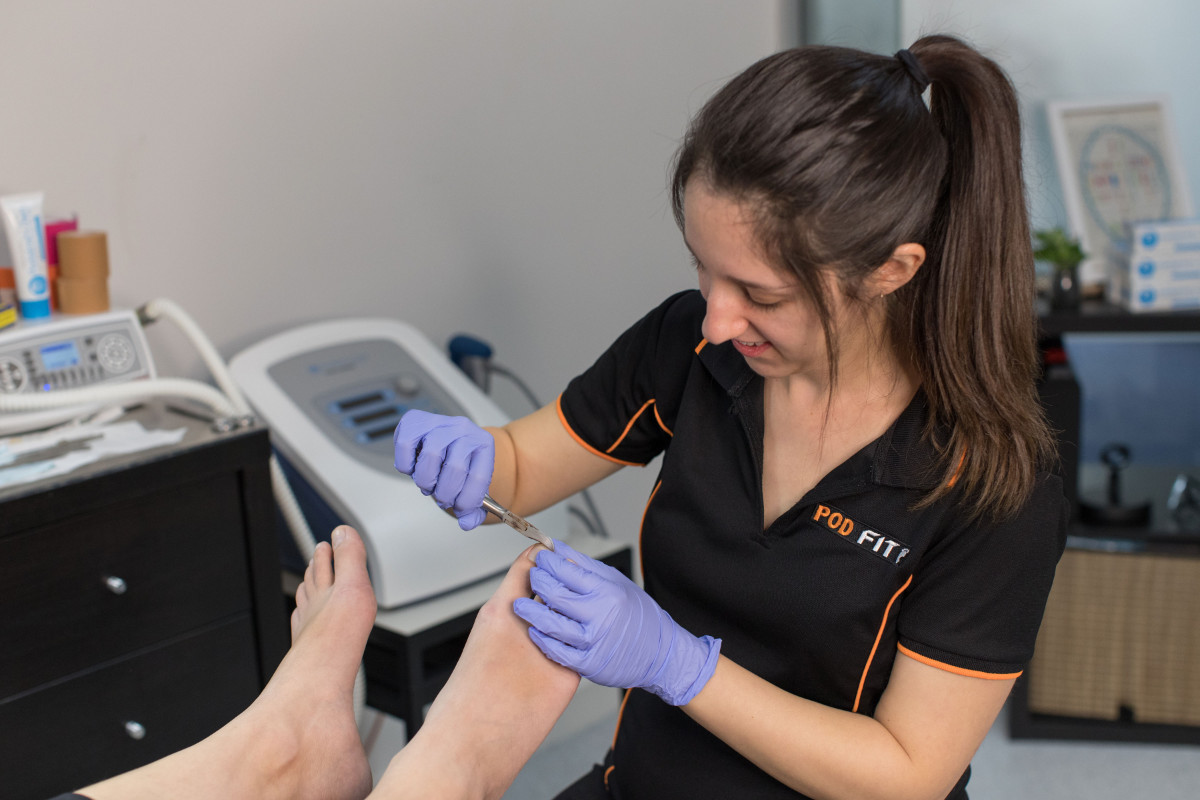 Podiatrist Melissa Performing Nail Procedure