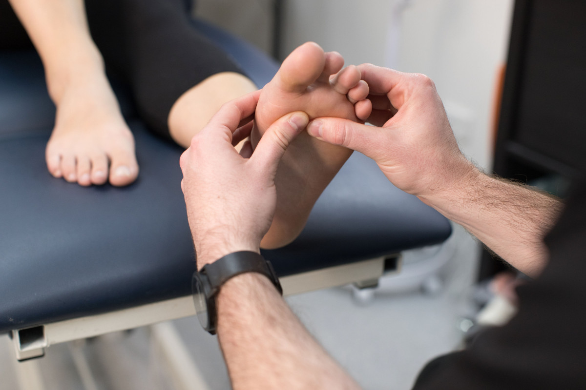 Podiatrists Fingers On Sole Of Foot Neuroma Treatment